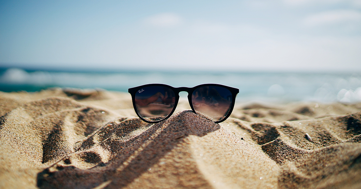 Sunglasses on beach in summer